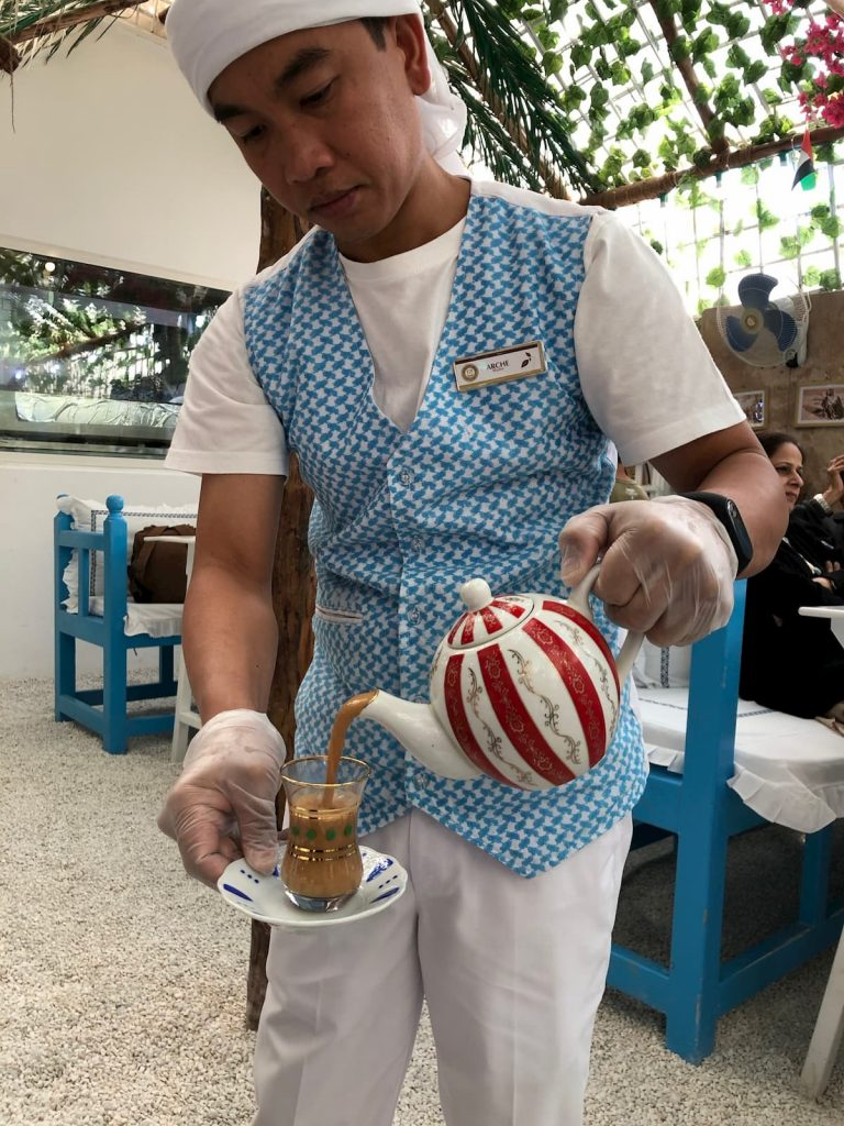 arabian-tea-house-old-town-dubai-server-hot-tea