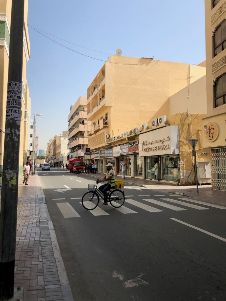 old-dubai-textile-district-man-bike-street